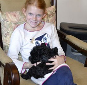 Little Girl with Black Puppy